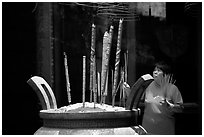 Offering incense at a Chinese temple in Cho Lon. Cholon, District 5, Ho Chi Minh City, Vietnam ( black and white)