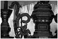Red color is believed to be lucky. Urn and incense coils, Cho Lon. Cholon, District 5, Ho Chi Minh City, Vietnam (black and white)