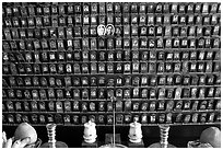 Pictures of the deceased for veneration on altar. Ho Chi Minh City, Vietnam ( black and white)