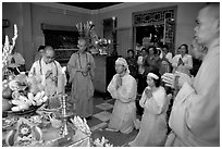 Buddhist funeral ceremony. White is color for mourning, Xa Loi pagoda, district 3. Ho Chi Minh City, Vietnam ( black and white)