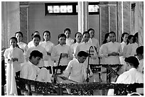 Traditional musicians during the noon ceremony. Tay Ninh, Vietnam ( black and white)