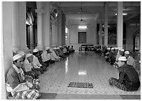 Ceremony in mosque in Cham minority village. Chau Doc, Vietnam ( black and white)