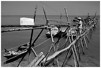 An ice block being loaded into a fishing boat. Vung Tau, Vietnam (black and white)