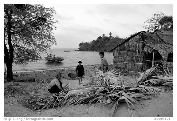 Fishing village with huts made of banana leaves. Hong Chong Peninsula, Vietnam (black and white)
