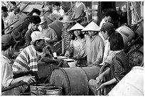 Filling up water tanks for the day. Ha Tien, Vietnam ( black and white)