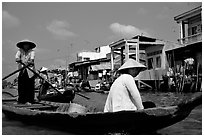 River at the back of townhouses, more used than the road at the front, Phung Hiep. Can Tho, Vietnam ( black and white)