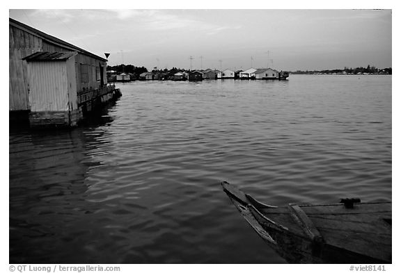 Floating houses. They double as fish reservoirs. Chau Doc, Vietnam (black and white)