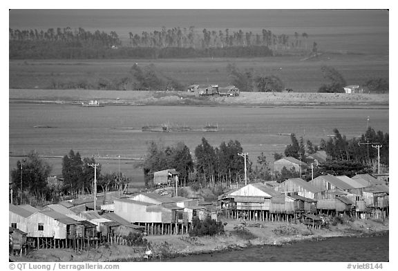 Stilts houses and inundated rice fields. Chau Doc, Vietnam (black and white)