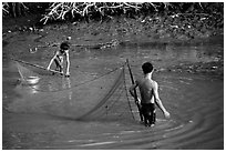 Fishing the river, near Long Xuyen. Mekong Delta, Vietnam (black and white)