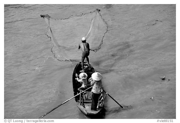 Fisherman casting net seen from above. Can Tho, Vietnam (black and white)