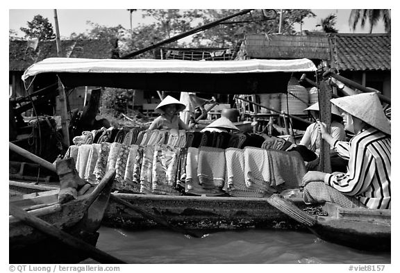 Garnments for sale on the Phong Dien floating market. Can Tho, Vietnam (black and white)