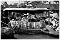 Garnments for sale on the Phong Dien floating market. Can Tho, Vietnam ( black and white)