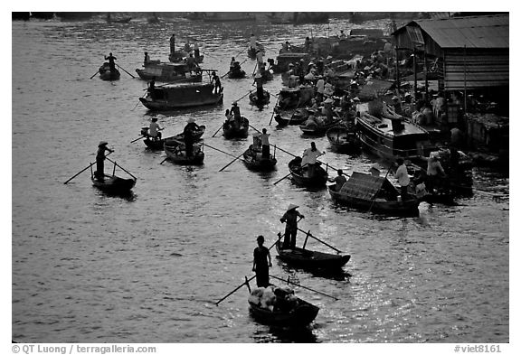 River activity at sunrise. Can Tho, Vietnam (black and white)