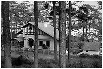 Basque style villa of colonial period in the pine-covered hills. Da Lat, Vietnam (black and white)