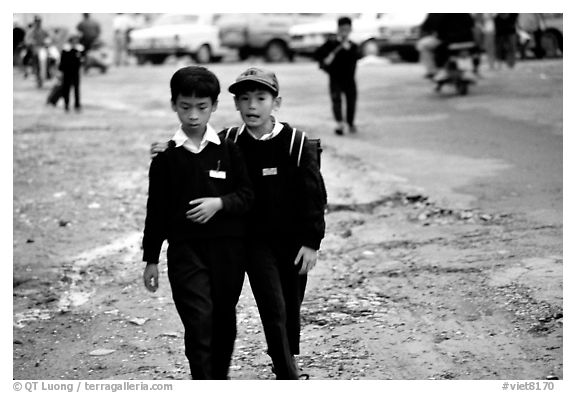 School children wear French-style chic sweaters. Da Lat, Vietnam (black and white)