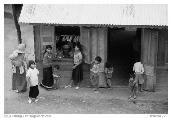 Gathering at the village store, in a minority village. Da Lat, Vietnam (black and white)