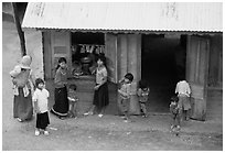 Gathering at the village store, in a minority village. Da Lat, Vietnam ( black and white)