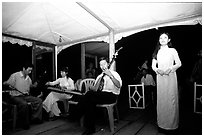 Traditional floating concert on the Perfume river. The city has remained Vietnam's artistic center. Hue, Vietnam (black and white)