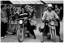Flower Hmong women getting a ride on all-terrain russian-made motorbikes to the sunday market. Bac Ha, Vietnam ( black and white)