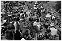 Colorful crowd at the sunday market, where people from the surrounding hamlets gather weekly to meet, shop and eat. Bac Ha, Vietnam (black and white)
