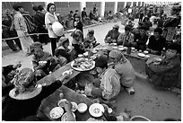 Festing on unusual foods, sunday market. Bac Ha, Vietnam (black and white)
