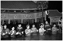 Artists salute after a water puppets performance in 1999. Hanoi, Vietnam (black and white)