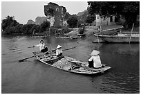 Villagers transport stones from the quary on Ken Ga canal. Ninh Binh,  Vietnam (black and white)