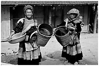 Flower Hmong women. The Hmong ethnie is divided into four subgroups, designated using the dress pattern they wear. Bac Ha, Vietnam ( black and white)