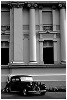 Classic Citroen car in front of city museum. Ho Chi Minh City, Vietnam (black and white)