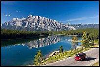 Car on the road besides Two Jack Lake. Banff National Park, Canadian Rockies, Alberta, Canada ( color)