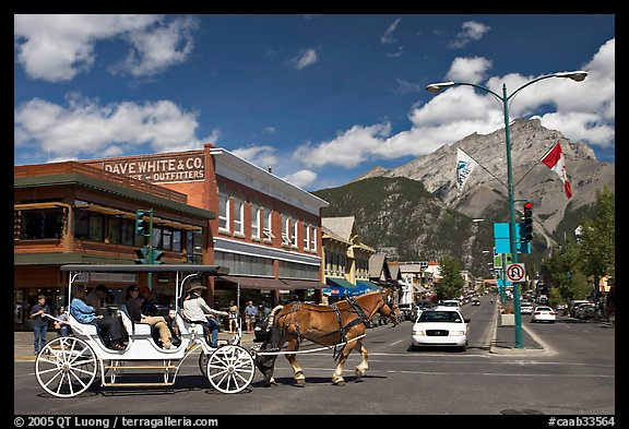 Horse carriage on Banff avenue. Banff National Park, Canadian Rockies, Alberta, Canada (color)