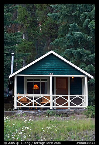 Cabin in the woods with interior lights. Banff National Park, Canadian Rockies, Alberta, Canada (color)