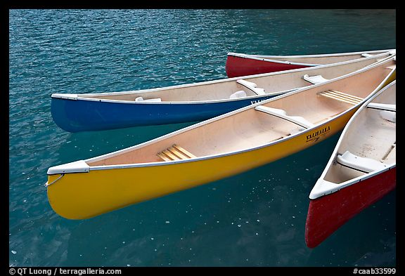 Close up of brightly colored canoes, Moraine Lake. Banff National Park, Canadian Rockies, Alberta, Canada (color)