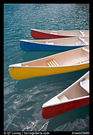 Close up of red, yellow and blue canoes, Moraine Lake. Banff National Park, Canadian Rockies, Alberta, Canada (color)