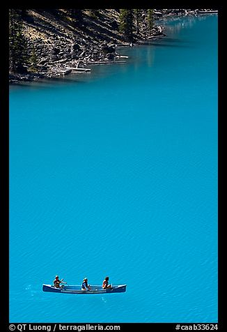 Canoe floatting in Robins egg blue water of Moraine Lake. Banff National Park, Canadian Rockies, Alberta, Canada (color)
