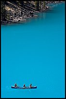 Canoe floatting in Robins egg blue water of Moraine Lake. Banff National Park, Canadian Rockies, Alberta, Canada ( color)