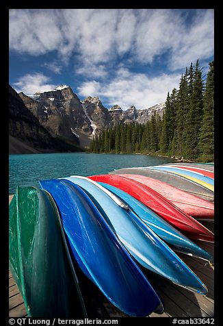 Colorful canoes stacked on the boat dock, Lake Moraine, morning. Banff National Park, Canadian Rockies, Alberta, Canada (color)