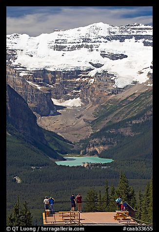 Tourists at observation platform, looking at  Lake Louise and  Victoria Peak. Banff National Park, Canadian Rockies, Alberta, Canada (color)