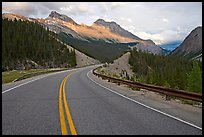 Twisting road, Icefields Parkway, sunset. Banff National Park, Canadian Rockies, Alberta, Canada ( color)