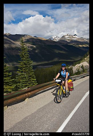 Woman cyclist, Icefieds Parkway. Jasper National Park, Canadian Rockies, Alberta, Canada (color)