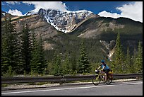 Woman cycling the Icefields Parkway. Jasper National Park, Canadian Rockies, Alberta, Canada ( color)