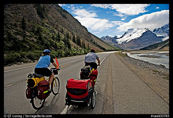 Couple cycling the Icefields Parkway. Jasper National Park, Canadian Rockies, Alberta, Canada (color)