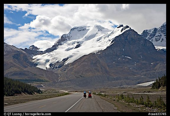 Cyclists on the Icefields Parkway at the base of Mt Athabasca. Jasper National Park, Canadian Rockies, Alberta, Canada (color)