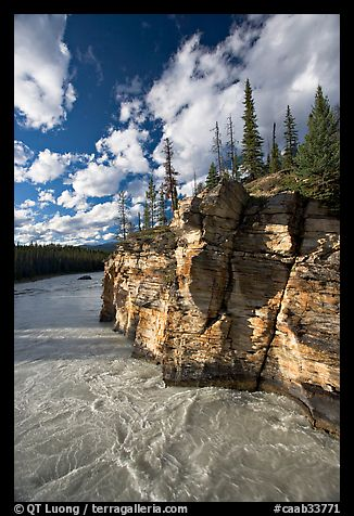Athabasca River and cliff, late afternoon. Jasper National Park, Canadian Rockies, Alberta, Canada (color)