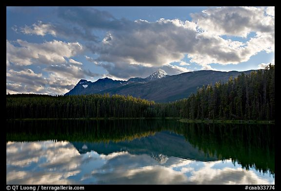 Peaks and clouds reflected in Leach Lake, sunset. Jasper National Park, Canadian Rockies, Alberta, Canada (color)