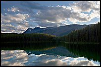 Peaks and clouds reflected in Leach Lake, sunset. Jasper National Park, Canadian Rockies, Alberta, Canada