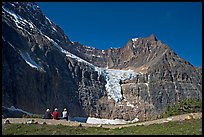 Hikers look at Angel Glacier, late morning. Jasper National Park, Canadian Rockies, Alberta, Canada ( color)