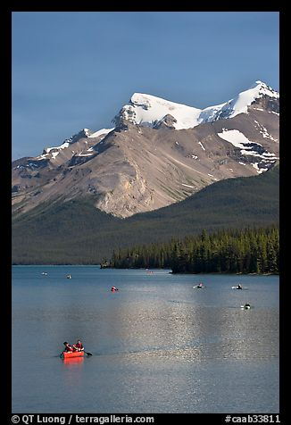 Red canoe on Maligne Lake, afternoon. Jasper National Park, Canadian Rockies, Alberta, Canada (color)