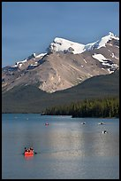 Red canoe on Maligne Lake, afternoon. Jasper National Park, Canadian Rockies, Alberta, Canada ( color)