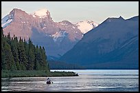 Canoist paddling on Maligne Lake at sunset. Jasper National Park, Canadian Rockies, Alberta, Canada